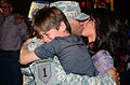 Army Sgt. Hector Jaime Sanchez, a communications Non-commissioned officer in charge, with Delta Battery, 4th Battalion, 5th Air Missile Defense Battalion, 69th Air Defense Artillery Brigade, embraces his 121103-A-DO086-276.jpg