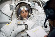 Astronaut Nicole Stott participates in an Extravehicular Mobility Unit spacesuit fit check