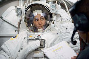 Nicole Stott - Nicole Stott participates in an Extravehicular Mobility Unit (EMU) spacesuit fit check.