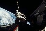 Astronaut Richard Gordon attaches a tether line from his spacecraft to Agena.jpg
