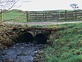 Auchengassel Burn draining under track - geograph.org.uk - 1073710.jpg