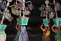 Aurangabad, ladies carrying lights for a wedding (9841465464).jpg