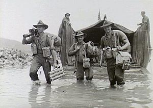 Landing at Jacquinot Bay - Image: Australian soldiers disembarking from a US Army landing craft at Jacquinot Bay on 4 November 1944