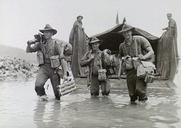 Australian soldiers disembarking from a US Army landing craft at Jacquinot Bay on 4 November 1944