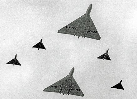 The prototype Vulcans (VX777 front, VX770 rear) with four Avro 707s at the Farnborough Air Show in September 1953. The large delta wings of the Vulcan quickly gave it the affectionate nickname of 'Tin Triangle'.[14]