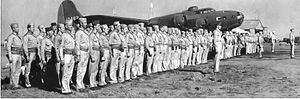Mareeba Airfield - USAAF 19th Bomb Group personnel on parade at Mareeba, with B-17E 41-2562 (Tojo's Jinx) (scrapped in New Guinea 1945) in late 1942