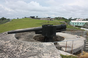 St David's Battery - One of the 6 inch Breech Loading (BL) guns, with the two 9.2 inch BLs visible beyond, and the barracks to the right, in 2011