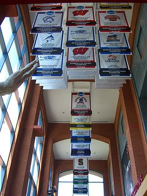 NCAA 2006 championship banners hang inside the...