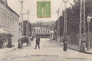 Louviers - La Rue de la Gare (the street of the railway station); picture postcard, 1920s.The town was served from 1872 to 1950 by the railway line Saint-Georges-Motel à Grand-Quevilly, which linked Rouen and Orléans.