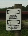 Bilingual manure tank warning.png