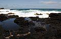Black rocks and the surf. (4573653057).jpg
