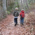 Boys walking down trail with leaves on path First Landing State Park (42346557260).jpg