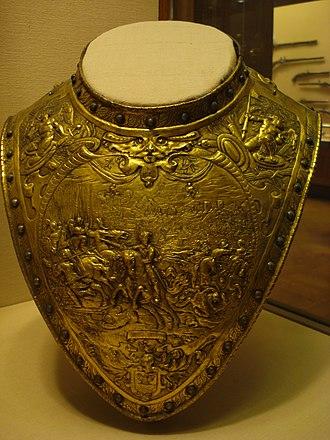 Gorget - Elaborately decorated gilt-brass gorget of c. 1630, probably Dutch