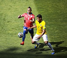 d2fc57a0f Vidal challenging Brazil s Hulk for the ball at the 2014 FIFA World Cup
