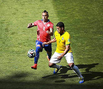 Arturo Vidal - Vidal challenging Brazil's Hulk for the ball at the 2014 FIFA World Cup