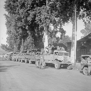 36th Indian Infantry Brigade - Troops of the 36th Indian Brigade prepare to move off by lorry from Buitenzorg at the start of an operation to clear the northern road between Batavia and Bandoeng of Indonesian nationalist snipers and ambush squads.