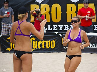 Sportswear (activewear) - US women's beach volleyball team has cited several advantages to bikini uniforms, such as comfort while playing on sand during hot weather. Photo shows US beach volleyball players Jennifer Fopma and Brooke Sweat in their uniforms.