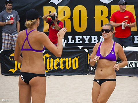 US women's team has cited several advantages to bikini uniforms, such as comfort while playing on sand during hot weather. Photo shows US national team players (Jennifer Fopma (left) and Brooke Sweat) in their uniforms. Brooke Sweat and Jennifer Fopma at Hermosa Beach 2012 (2) (cropped).jpg