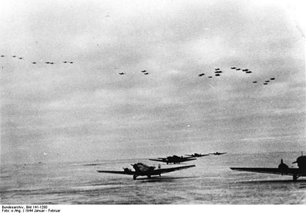 Ju 52s at Korsun airfield, Ju 87s in formation above (January 1944). Bundesarchiv Bild 141-1280, Russland, Kessel Tscherkassy.jpg
