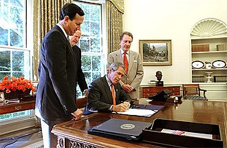 Rick Santorum - Santorum, Sen. Arlen Specter, and Rep. John Murtha watch President George W. Bush sign the Flight 93 National Memorial Act.