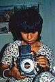 Cô gái bên chiếc máy ảnh 1970 (9680585744).jpg