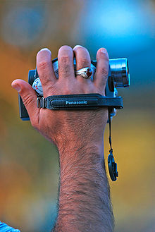 Small camcorder being operated with one hand