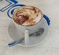 Cappuccino on surface with blue markings.jpg