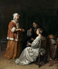 Interior with two young women in conversation and a man showing a coin