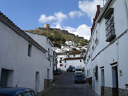 View of the medieval castle of Jimena de la Frontera as seen from one of its streets.