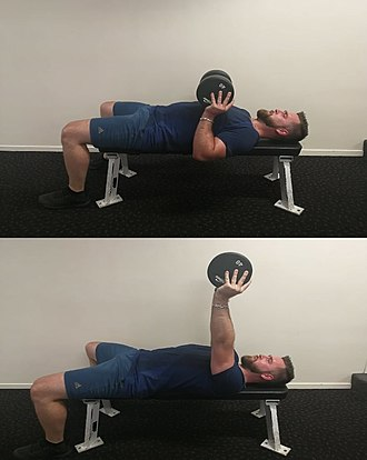 Bench press - Phil Collins performs the Collins Press with the dumbbell held between both hands.