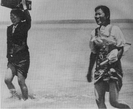 Comfort women crossing a river following soldiers.png