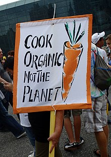 b99dd141915 Placard advocating organic food rather than global warming.
