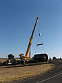 Crane lifts toppled turbine (14877214638).jpg