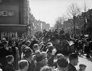 Canadian Armed Forces - Canadian troops of the Stormont, Dundas and Glengarry Highlanders welcomed by liberated crowds in Leeuwarden, Netherlands, 16 April 1945.