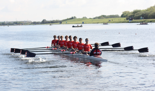 Rowers in a coxed eight (8+), a sweep rowing boat DMURC mens 8+ at BUCS Regatta 2010.png