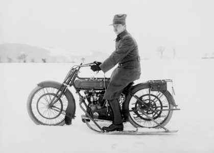 Swiss WW1 soldier biker on a motorcycle/snowmobile crossover.