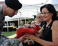 Debbi Miller receives a bouquet of flowers during her husband, Deputy Commanding General of the U.S. Army Reserve Command Maj. Gen. Jon J. Miller's retirement ceremony at Arizona State University Campus 121006-A-ZZ999-001.jpg