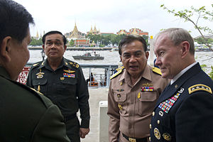 Prayut Chan-o-cha - Prayut (left) meets US General Martin Dempsey (right) during his visit to Bangkok (2012)
