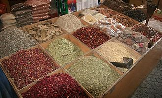 Dubai Spice Souk - An outdoor store in the Spice Souk displaying a variety of spices, herbs and nuts