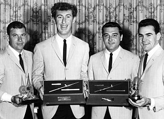 The Delltones - The Delltones with four radio awards, (l to r) Warren Lucas (tenor), Ian (Peewee) Wilson (bass), Brian Perkins (baritone) and Col Loughnan (lead)