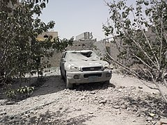 Destroyed car in the south of Sanaa 12-6-2015-2