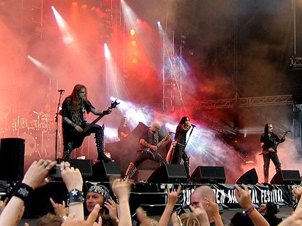 Dimmu Borgir (pictured) plays black metal music that features synthesizers and orchestras. DimmuBorgirTuska2005.jpg
