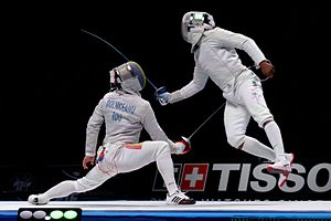 Daryl Homer - Homer (R) scores from a flunge at the 2015 World Fencing Championships