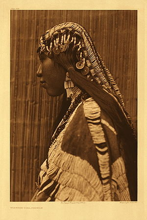 Dentalium shell - Wishram woman wearing a dentalium shell bridal headdress and earrings, photo by Edward Curtis