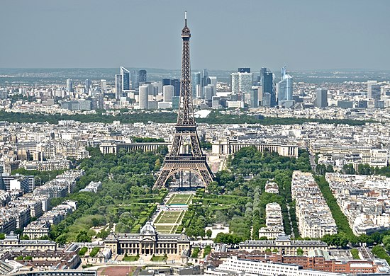 The Eiffel Tower and the La Defense disctrict. Eiffel Tower from the Tour Montparnasse 3, Paris May 2014.jpg