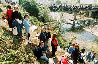 Water politics - People waiting in line to gather water during the Siege of Sarajevo