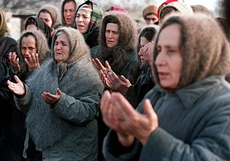 First Chechen War - Chechen women pray for Russian troops not to advance towards the capital Grozny, December 1994.