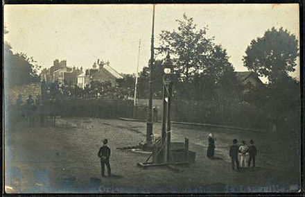 Retouched photo of the execution of Languille in 1905. Foreground figures were painted in over a real photo. Execution of Languille in 1905.jpg