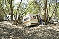 FEMA - 32304 - FEMA Community Relations worker inspecting a damaged travel trailer in Minnesota.jpg