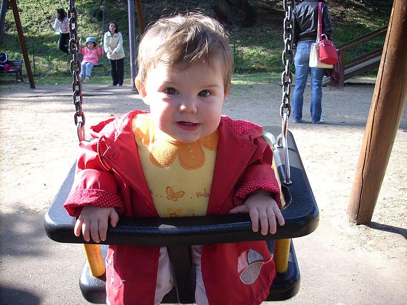 File:Female child ten months old on swing.JPG